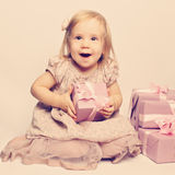 Happy baby and great gifts Stock Photography