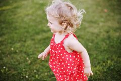 Happy baby on green grass background royalty free stock photos
