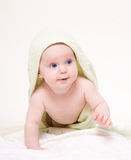 Happy baby with green towel. Royalty Free Stock Images