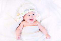 Happy baby in hand made cross stitch hooded towel Stock Photography