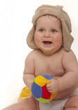 Happy baby with hat and ball Stock Image