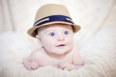 Happy baby in hat Stock Images