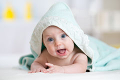 Happy baby infant in towel after bathing Stock Image