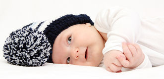 Happy baby with knitted hat Royalty Free Stock Image