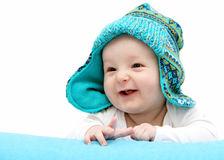 Happy baby in knitted hat Stock Images