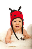 Happy baby in ladybug hat Stock Photography