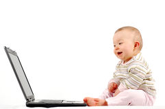 Happy baby with laptop #13 Royalty Free Stock Image