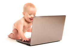 Happy baby and a laptop computer isolated Royalty Free Stock Photos