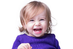 Happy Baby Laughing Freely. Happy baby is laughing fearless and freely with her new teeths, looking in to camera. Isolated on white stock photo