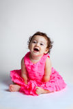 Happy Baby Leaning Forward Pink Dress Royalty Free Stock Images