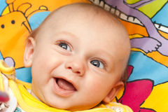 Happy baby lies on a back Royalty Free Stock Images