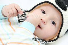 Happy baby lies on back Royalty Free Stock Photography