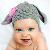Happy baby like a bunny or lamb. Happy baby in the hat like a bunny or lamb Stock Image