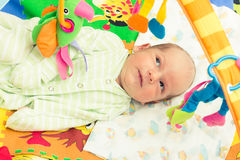 Happy baby. Little baby playing with toys at home Stock Photos
