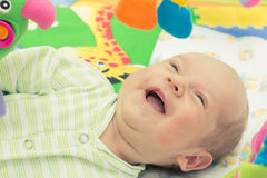 Happy baby. Little baby playing with toys at home Stock Images