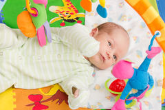 Happy baby. Little baby playing with toys at home Royalty Free Stock Image