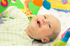 Happy baby. Little baby playing with toys at home Stock Image