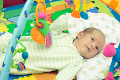 Happy baby. Little baby playing with toys at home Royalty Free Stock Images