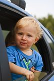 Happy baby looking from the car window Royalty Free Stock Photo