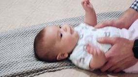 Happy baby is lying on the bed stock video
