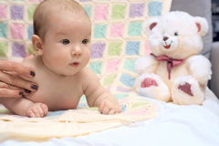 Happy baby lying on his stomach Stock Photos