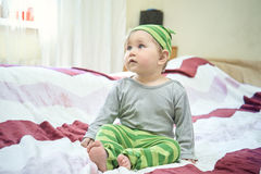 Happy baby lying on his stomach Royalty Free Stock Photography