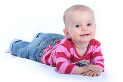 Happy baby lying isolated on white Royalty Free Stock Images