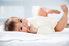 Happy baby lying Stock Photo