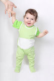 Happy baby making first steps Stock Photography