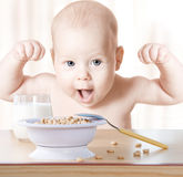 Baby Food. Happy Kid eating cereal milk, Strong Healthy Child. Baby Food. Happy Kid eating cereal and milk. Meal breakfast for Strong Healthy Child royalty free stock photos
