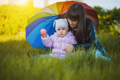 Happy baby and mom are playing in the park Stock Images