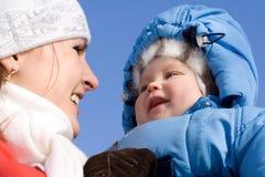 Happy baby with mother 2. Happy baby with mother on blue sky. Spring. 2 Stock Photo