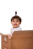 Happy baby in moving box Royalty Free Stock Photography