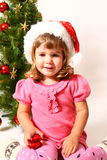 Happy baby near Christmas tree  Stock Images