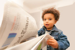 Baby Reads New York Times. Happy Baby Reads New York Times Newspaper Royalty Free Stock Photography