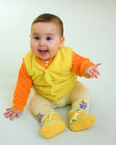 Happy baby in orange dress Stock Images