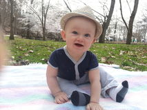 Happy Baby Outside Wearing Fedora Stock Photography