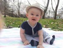 Happy Baby Outside Wearing Fedora Stock Photography