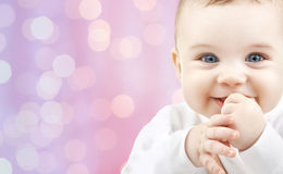Happy baby over pink lights background Royalty Free Stock Photography