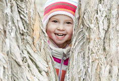 Happy baby in the park. Happy child in a park in the striped hat royalty free stock photos