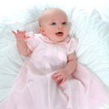 Happy Baby in Pink. Smiling baby girl in pink on white background Stock Photo