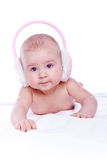 Happy baby with pink fur headphones Royalty Free Stock Photo