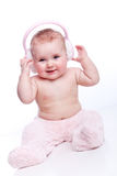 Happy baby with pink fur headphones Royalty Free Stock Image