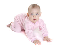 Happy baby in a pink suit Stock Image