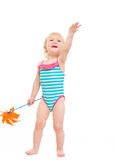 Happy baby with pinwheel pointing up Stock Images
