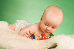 Happy baby playing. Happy baby lie on carpet and playing Stock Photo