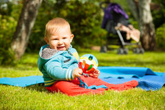 Happy Baby Playing with Ball Outdoors Royalty Free Stock Photo