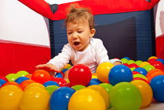 Happy baby playing with balls Royalty Free Stock Photo