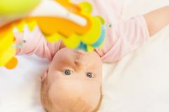 Happy baby playing with children's musical mobile toy Royalty Free Stock Images