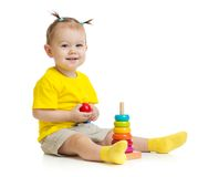 Happy baby playing with colorful wood pyramid Royalty Free Stock Images
